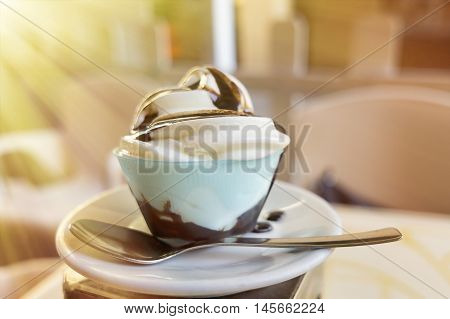 frozen yogurt with chocolate topping in an outdoor cafe