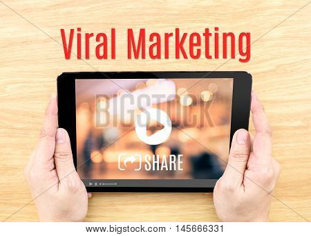 Hand Holding Tablet With Viral Marketing Word On Wood Table ,internet Business Concept.