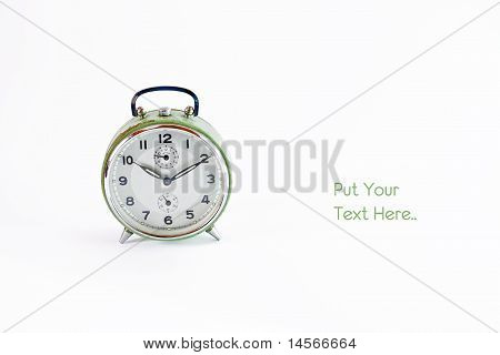 Old Vintage Green Alarm Clock Isolated On White With Left White Space For Text