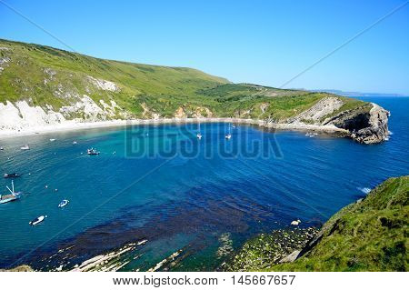Elevated view of boats moored in the cove Lulworth Cove Dorset England UK Western Europe.