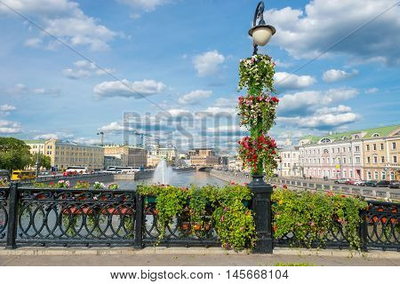 Lantern and the railing of the bridge decorated with fresh flowers