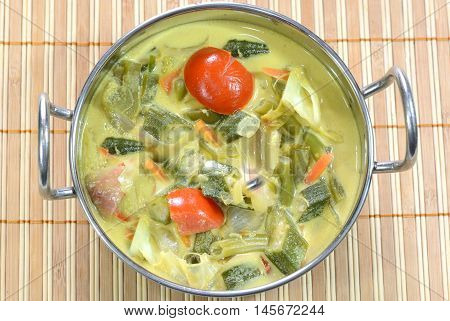 Kari Sayur is a popular vegetarian dish in Malaysia. It is indo- malaysian style cuisine made of vegetables and coconut milk.