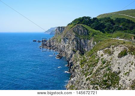 Elevated view along the rugged Jurassic coastline Lulworth Cove Dorset England UK Western Europe.