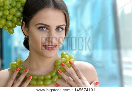 Girl Tries On A Beads From Grapes Like A Necklace