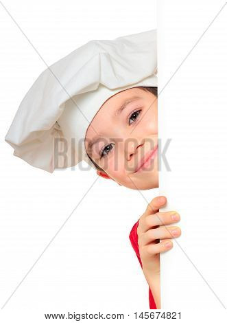 Chef boy looking from behind the wall isolated on white background