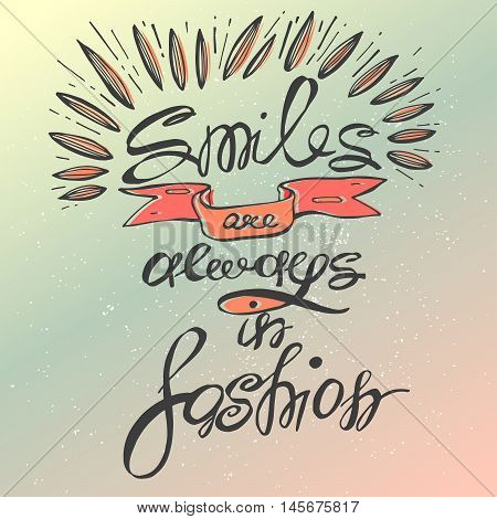 Smiles are always in fashion. Inspirational quote handwritten with black custom lettering for posters t shirts and cards. Vector calligraphy on gradient background.Inspirational vector typography