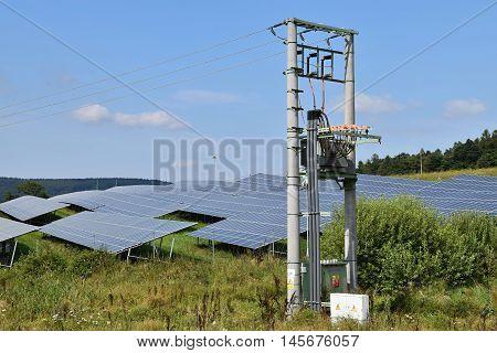 Solar powerplant and electricity pylons. Solar powerplant.