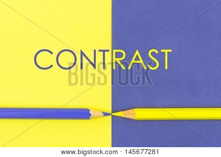 Word Contrast Written Over Yellow And Violet Coloured Paper