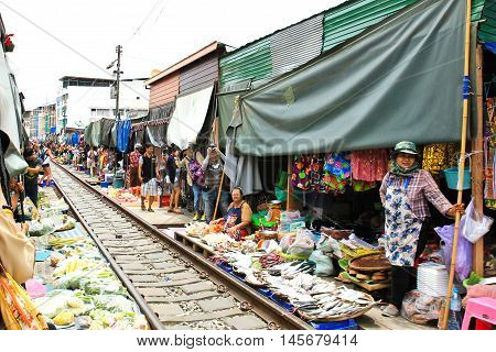 SAMUT SONGKHRAM THAILAND - SEPTEMBER 4 2016 : The famous railway market or folding umbrella market at Samut Songkhram Thailand A famous market in Thailand and sixth times a day the train runs through these stalls.