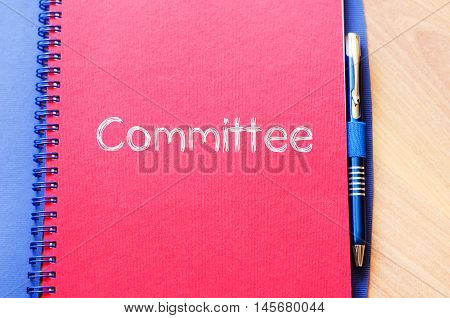 Committee text concept write on notebook .