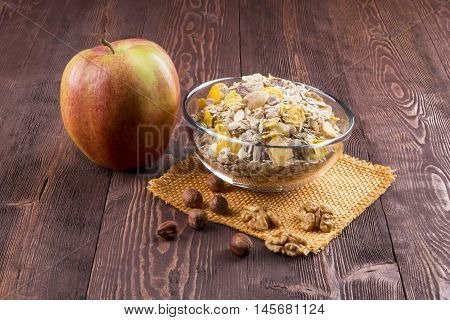 bowl of muesli apple nuts flakes candied for a nutritious breakfast with a low glycemic index ensuring plenty of energy for the day.