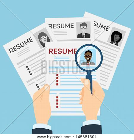 Resumes with magnifier at the table. Cv resume concept. Finding a worker. Apply for a job. Business opportunity. Cv profile. Finding new staff.