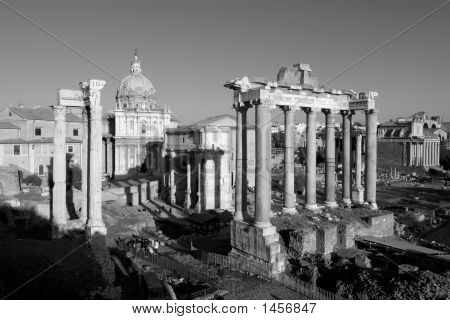 black and white picture of the roman forum with the temple of vespasian in the foreground poster