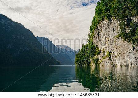 Cliffed coast of lake Konigssee Berchtesgadener Land Bavaria Germany