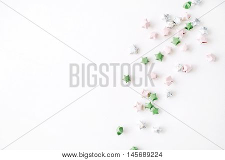 colored tinsel or frippery pattern on white background. flat lay top view