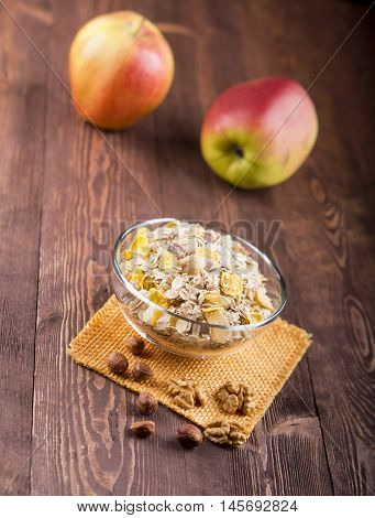 Bowl Of Muesli, Apple, Nuts, Flakes, Candied  For A Nutritious Breakfast With A Low Glycemic Index E