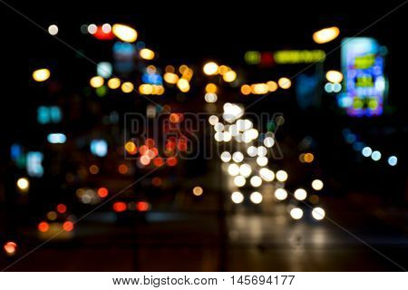 Light car on the road at night Scene (Bokeh blur style)