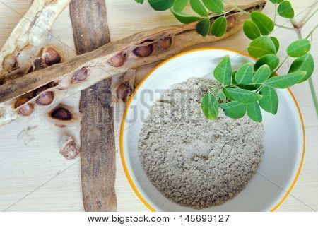 Moringa Leaf And Moringa Seed On Wooden Board Background