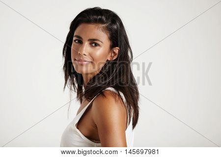 pretty spanish woman with nude makeup in studio