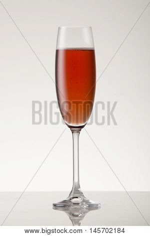Rose champagne in a champagne flute on a clear background.