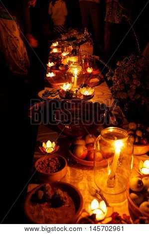 nocturnal wedding feast held in nature with enchanting lotus shape cande holders