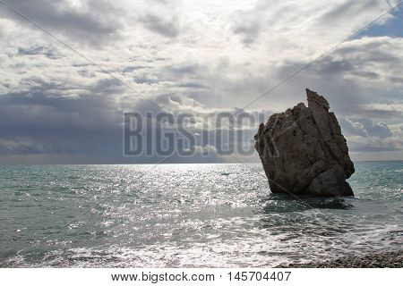 Rock in the sea near the coast of Aphrodite in Cyprus
