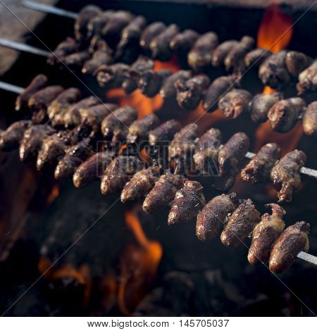 Churrasco, Traditional Brazilian Barbecue, Chicken Hearts Grilled Kebabs.