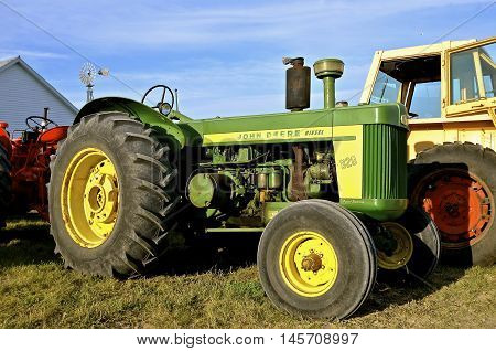 ROLLAG, MINNESOTA, Sept 1, 2016: An old 820  diesel John Deere tractor is displayed at the West Central Steam Threshers Reunion(WCSTR) where 1000s attend each Labor Day weekend in Rollag, MN each year.