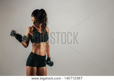 Athletic Woman Lifting Chrome Weights