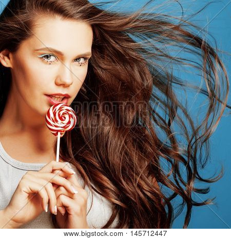 young pretty adorable woman with candy close up like doll makeup