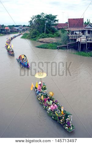 AYUTTHAYA, THAILAND - JULY 15, 2011 : Beautiful flower boats in floating parade, the unique annual Lad Chado candle floating festival of Buddhist lent on July 15, 2011 in Lad Chado canal, Ayutthaya Province, Middle  of  Thailand.