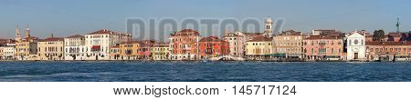 VENICE ITALY - DECEMBER 19: Panorama of Giudecca Canal Houses in Venice on DECEMBER 19 2012. Long Waterfront Cityscape in Venice Italy.
