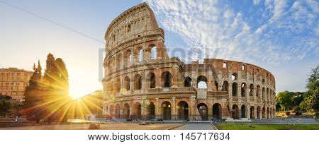 Panoramic view of Colosseum in Rome and morning sun Italy Europe.