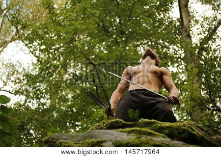 3 September 2016. Kozelsk Russia. Swordsman in the forest
