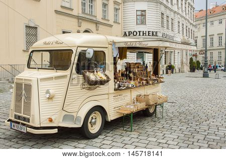 VIENNA, AUSTRIA - JUN 10, 2016: Vintage mobile market car with trader's showcase food and cosmetics for sale outdoor on June 10, 2016. Vienna has population near 1.8 million