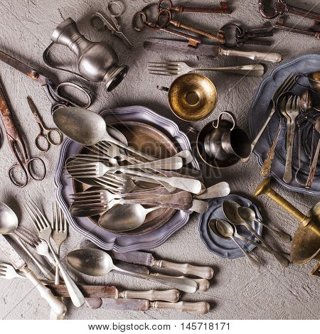 Rarity collectible goods - old cutlery, scissors, keys of different shapes and sizes, old mortar with pestle.