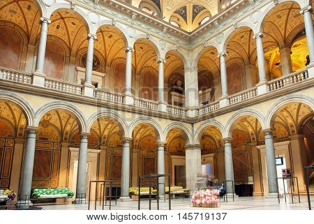 VIENNA, AUSTRIA - JUN 10, 2016: Interior of courtyard of Museum of Applied Arts with stone columns and couches on June 10, 2016. MAK has collection of design architecture and contemporary art from 1864