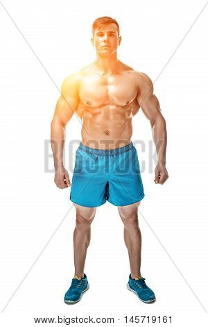 Strong Athletic Man showing muscular body and sixpack abs isolated white background. with sun flare
