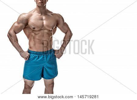 Strong Athletic Man showing muscular body and sixpack abs isolated white background. Close up, copyspace