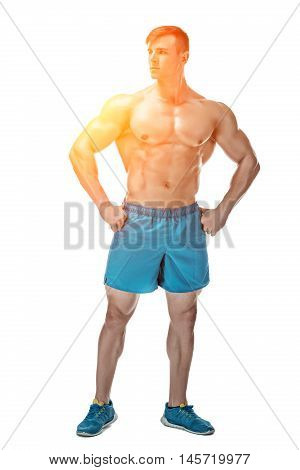 Strong Athletic Man showing muscular body and sixpack abs isolated on white background. full-length with sun flare