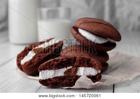 Broken Cookies And Stack Of Sponge Cookies With Cream On Paper. Closup.bottle And Glass With Milk De