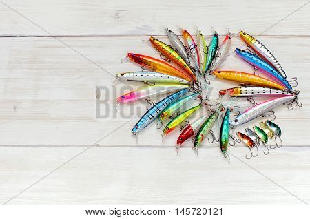Colorful Fishing Lures On Wood Desk