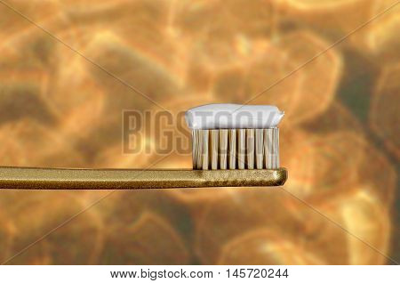 Tooth Brush With Tooth Paste On Golden Bokeh Background
