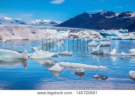 Ice lagoon in Iceland. Magnificent summer morning in the ocean gulf with floating ice floes