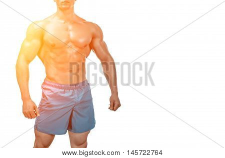 Strong Athletic Man showing muscular body and sixpack abs isolated on white background. with sun flare. Close up, copyspace