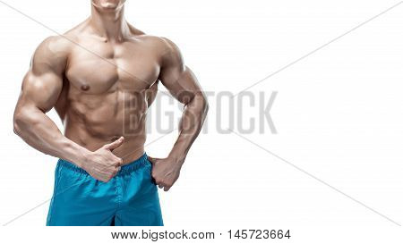 Strong Athletic Man showing muscular body and sixpack abs isolated on white background. Close up, copyspace