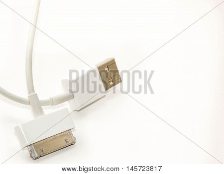 White wire usb mobile charging cable. 2 different cellphone charging plugs adapter from USB isolated white background