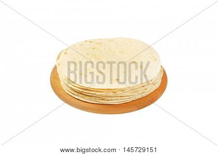 stack of flour tortillas on wooden cutting board
