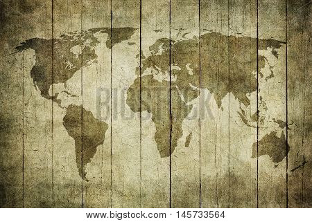 vintage map of the world over wooden background