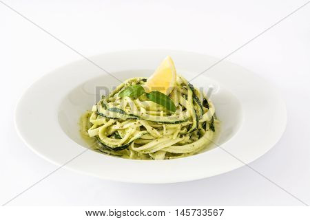 Zucchini noodles with pesto sauce and spiralizer isolated on white background
